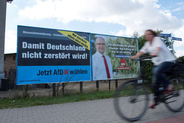An election poster for the right-wing party AfD (left).
